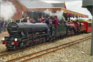 The double-headed train prepares to leave Wroxham Station on the Bure Valley Railway